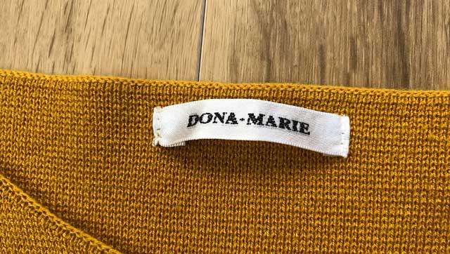 エアークローゼットの6箱目で届いた袖が特徴的なワンピースのブランド「DONA-MARIE(ドナ・マリー)」のタグ写真
