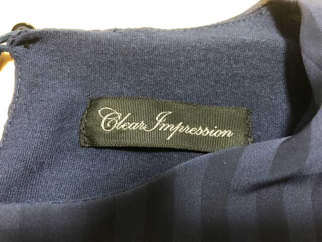 エアークローゼットの3箱目で届いたフェミニンなブラウスのブランド「CLEAR IMPRESSION」のタグ写真
